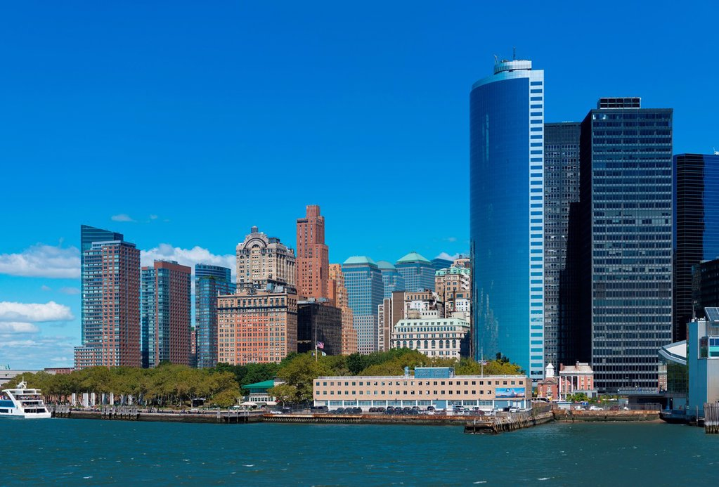 Lower Manhattan skyline with Battery park and Financial district skyscrapers : Stock Photo
