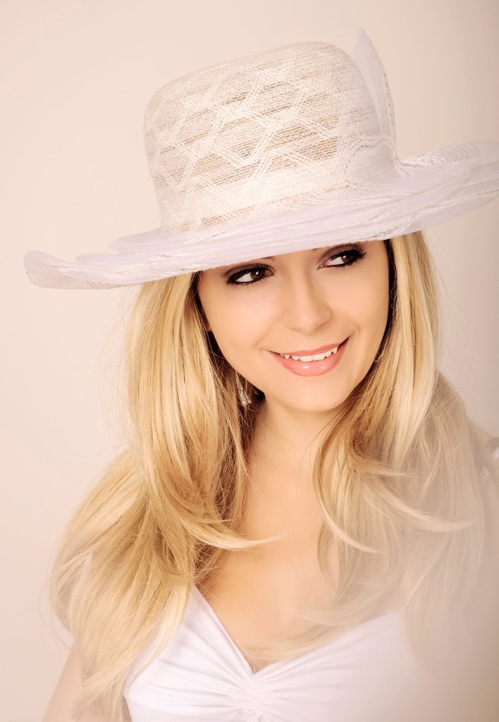 Stock Photo: 1566-1182502 Beautiful girl wearing white hat
