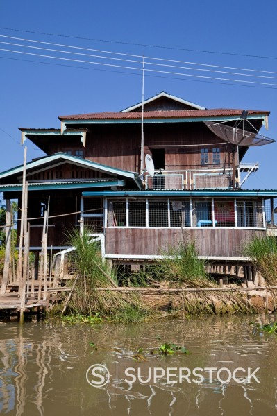 Stock Photo: 1566-1183029 Myanmar, Burma  Village House on Stilts, with Satellite Dish, Inle Lake, Shan State
