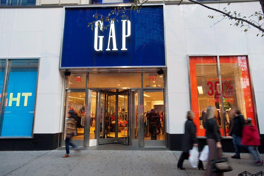 Stock Photo: 1566-1184706 Shoppers outside the Gap store in the Herald Square shopping district in New York
