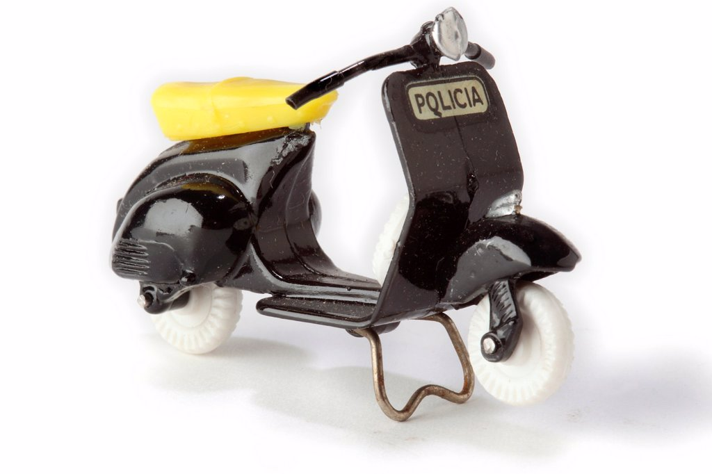 Antique toys  Collecting  Vespa motorcycle police  Brand Dalia, Spain, 60s : Stock Photo