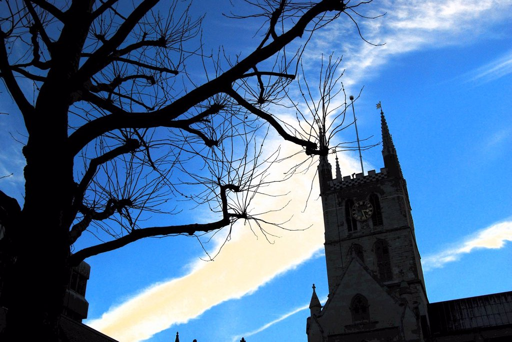Stock Photo: 1566-1187325 Southwark Cathedral by London Bridge and the River Thames in London, UK, on a bright, cold late-afternoon in Winter