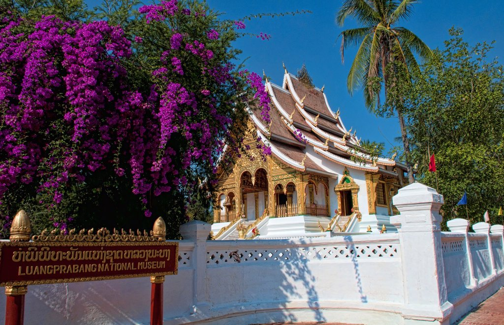 Stock Photo: 1566-1187715 Luang Phabang National Museum with gold and wonderful architecture with flowers temple in Laos Loa Asia