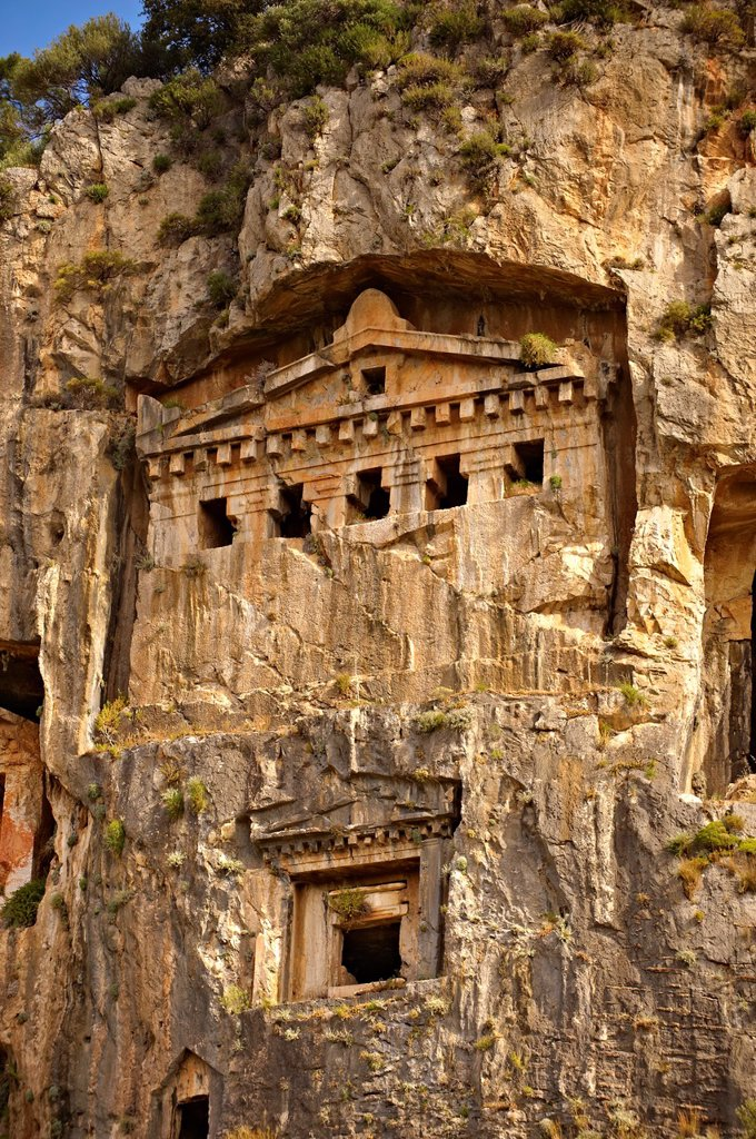 Stock Photo: 1566-1190280 The Hellenistic temple fronted Tombs of Kaunos, 4th - 2nd cent  B C , just outside the archaeological site of Kounos on the oposite side of the Calbys river from Dalyan, Turkey  Kaunos is on the border of Lycia & Caria and the Kaunos rock tombs differ sli. The Hellenistic temple fronted Tombs of Kaunos, 4th - 2nd cent  B C , just outside the archaeological site of Kounos on the oposite side of the Calbys river from Dalyan, Turkey  Kaunos is on the border of Lycia & Caria and the Kaunos rock tomb