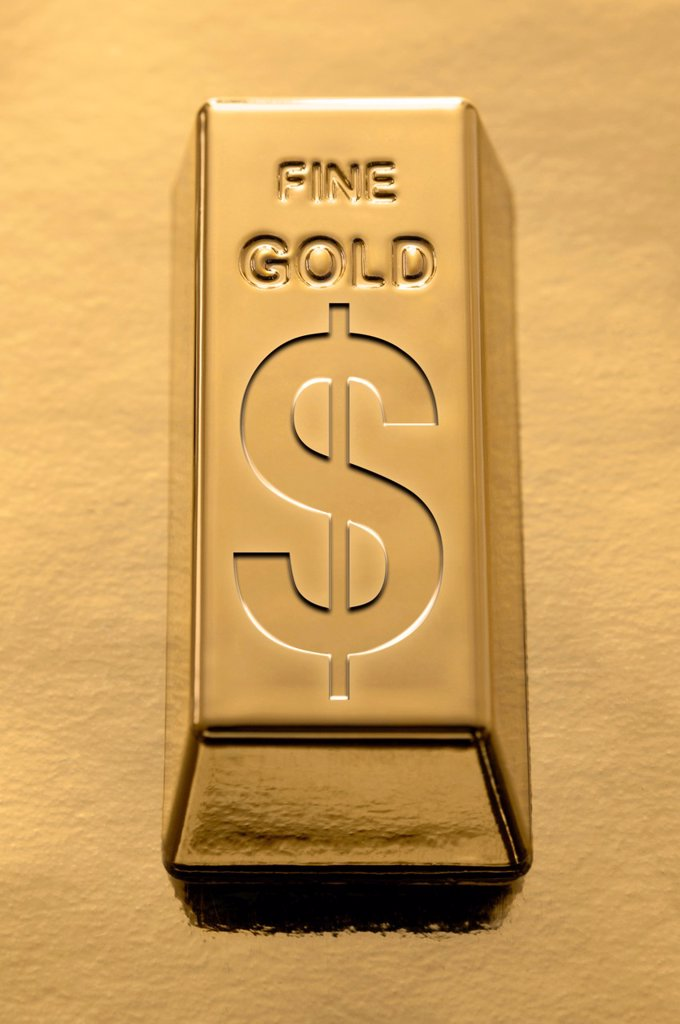 Stock Photo: 1566-1190834 Gold Bar with a Dollar symbol embossed on it on a gold background
