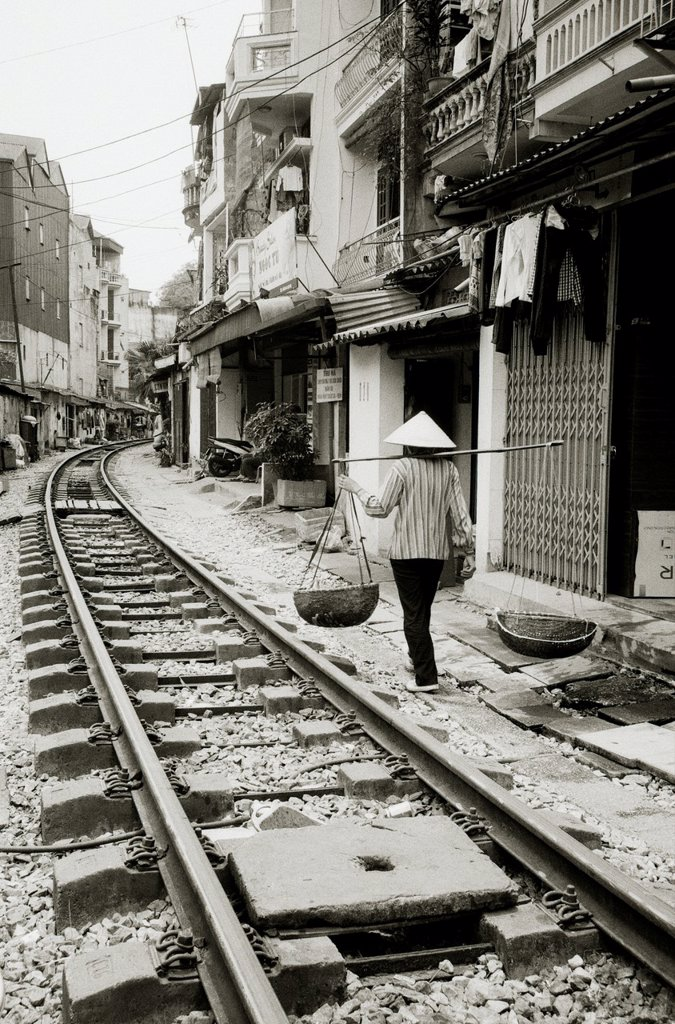 Stock Photo: 1566-1191779 Daily life by the train tracks in Hanoi in Vietnam