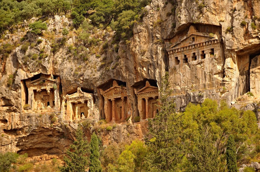 Stock Photo: 1566-1192140 The Hellenistic temple fronted Tombs of Kaunos, 4th - 2nd cent  B C , just outside the archaeological site of Kounos on the oposite side of the Calbys river from Dalyan, Turkey  Kaunos is on the border of Lycia & Caria and the Kaunos rock tombs differ sli. The Hellenistic temple fronted Tombs of Kaunos, 4th - 2nd cent  B C , just outside the archaeological site of Kounos on the oposite side of the Calbys river from Dalyan, Turkey  Kaunos is on the border of Lycia & Caria and the Kaunos rock tomb