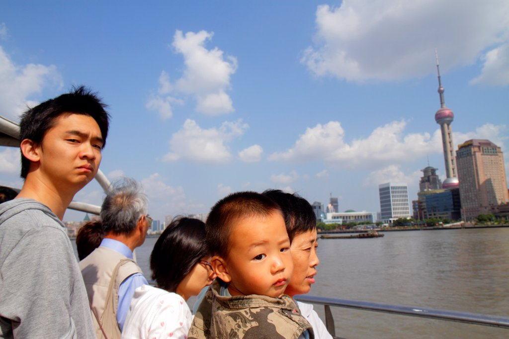 China, Shanghai, Huangpu River, Jinling East Road Dongchang Road Ferry, passengers, Asian, grandmother, woman, man, boy, grandson, holding, deck, Oriental Pearl Tower, Pudong Xin Qu District, : Stock Photo