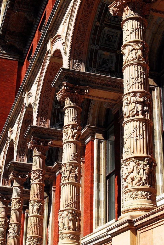 Stock Photo: 1566-1193611 Intricately carved stonework on the pillars of a nineteenth century collonade in Exhibition Road, the heart of London´s museum district, on a fine day in southern England
