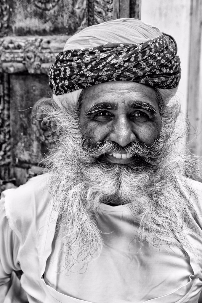 Stock Photo: 1566-1194697 Jodhpur at Fort Mehrangarh in Rajasthan India a great image of bearded character man guard in doorway of Fort Palace in costume