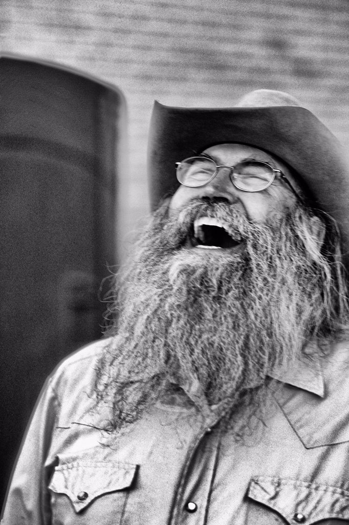 Abstract portrait of laughing cowboy with gray beard in Billings Montana : Stock Photo