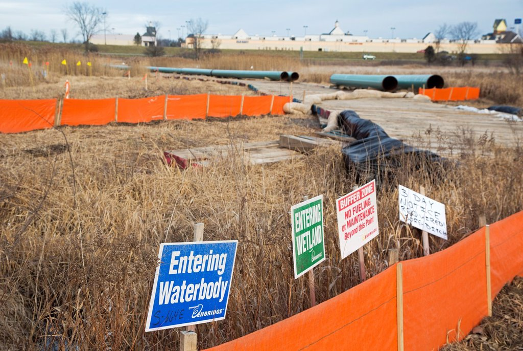 Stock Photo: 1566-1195023 Howell, Michigan - Oil pipeline construction  The new line will replace sections of Enbridge´s 6B pipeline which ruptured in 2010, spilling nearly a million gallons of Canadian tar sands oil into the Kalamazoo River