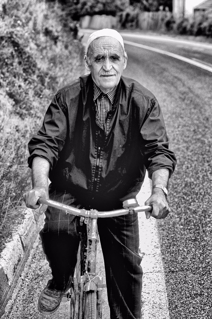 Stock Photo: 1566-1195359 Man on bicycle in Albania near Tirana