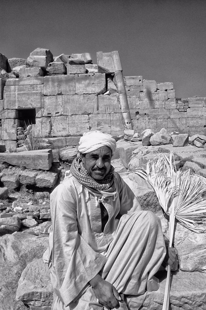 Local guide at the ancient ruins of the Temple of Karnak in Luxor Egypt : Stock Photo