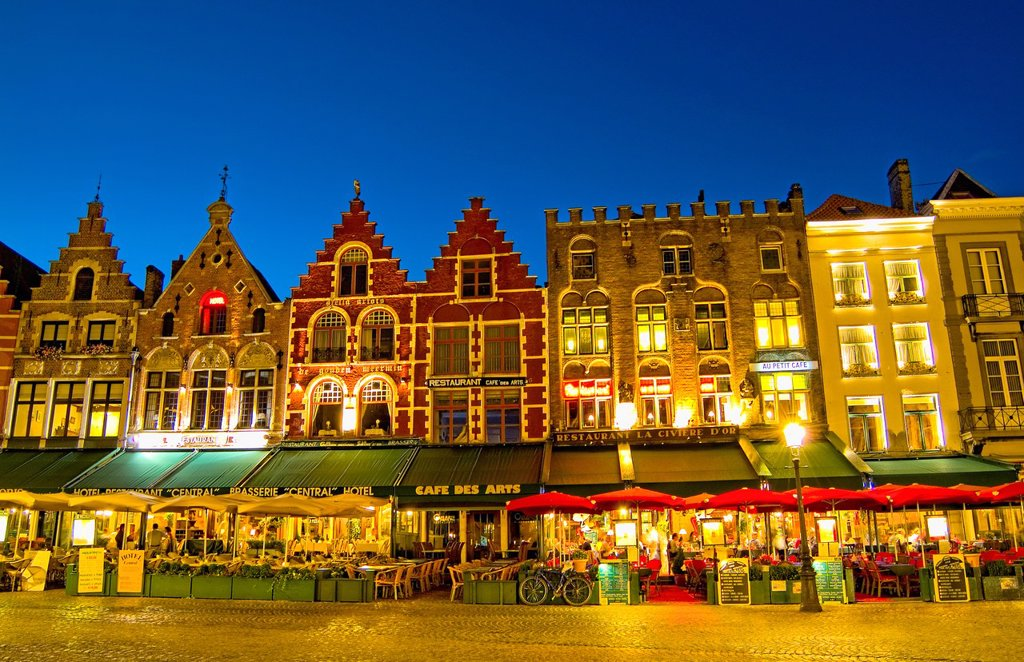 Stock Photo: 1566-1196341 Belgium night photo of colorful cafes in Marketplace in downtown Bruges Belgium