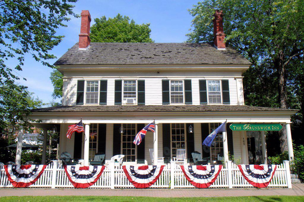 Maine, Brunswick, Park Row, The Brunswick Inn, patriotic, bunting, picket fence, Americana, : Stock Photo