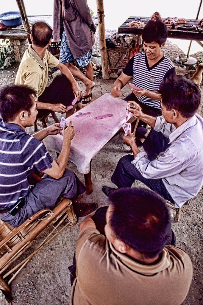 Local men paying Chinese cards in unique Guilin Yangshuo area of China : Stock Photo