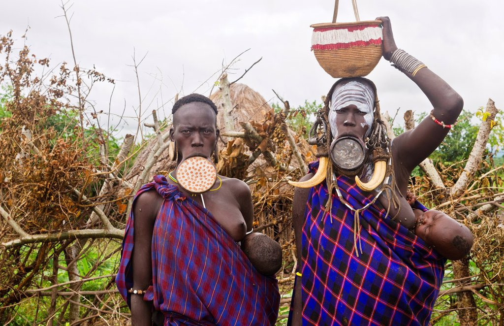 Mago National Park Ethiopia Africa Mursi tribe women Lower Omo Valley with clay pots in lips tradition tribal wild pottery 15 : Stock Photo