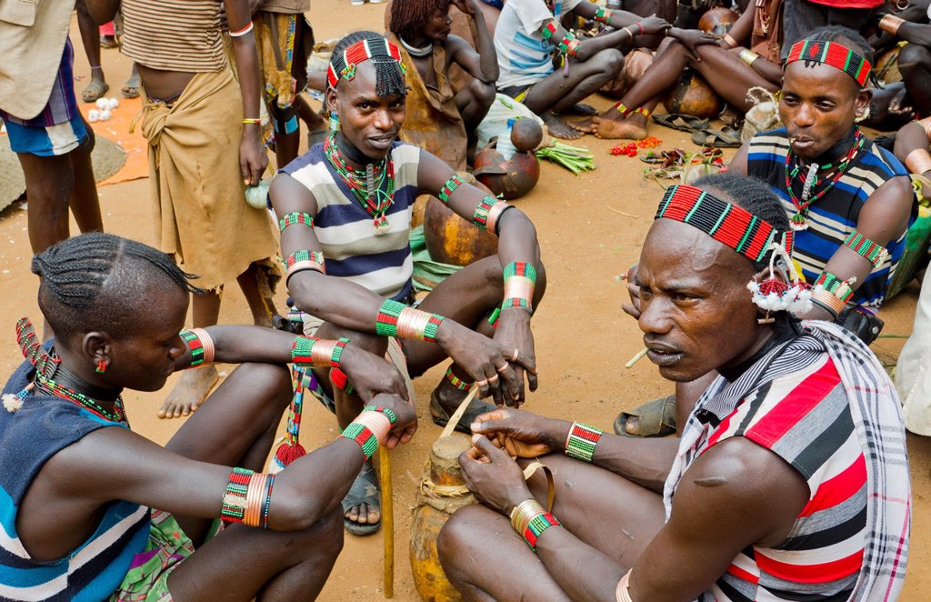 Stock Photo: 1566-1199788 Dimeka Ethiopia Africa Lower Omo Valley market with Bena boys talking in group 16