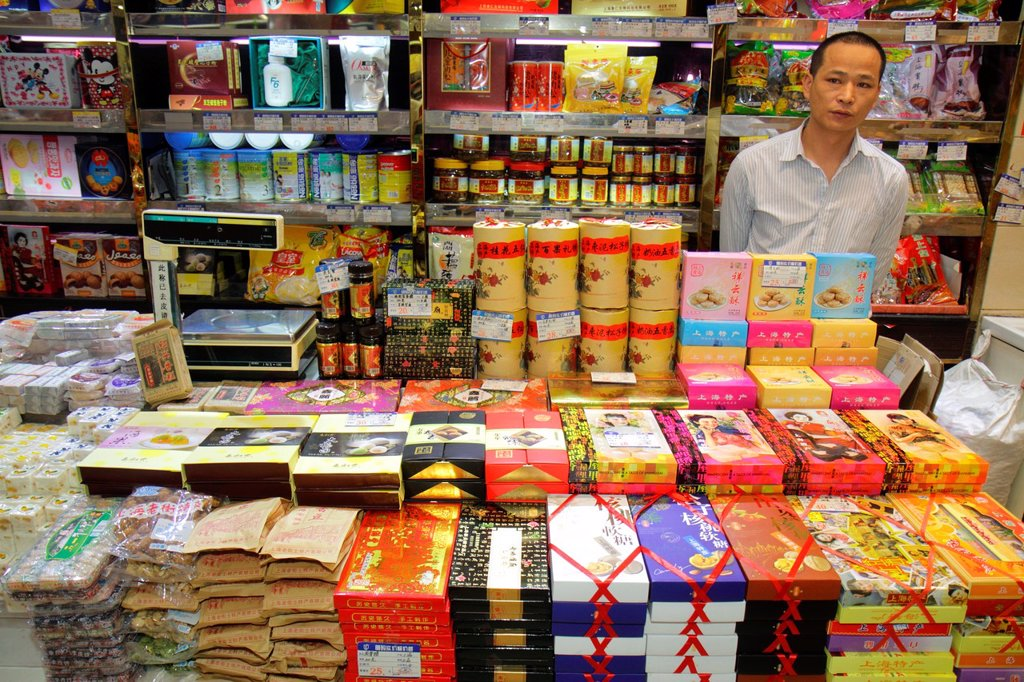 Stock Photo: 1566-1199876 China, Shanghai, Huangpu District, East Nanjing Road, business, store, candy, sweets, treats, Asian, man, clerk, job, employee, Chinese Mandarin symbols, hanzi, display, for sale, shopping,