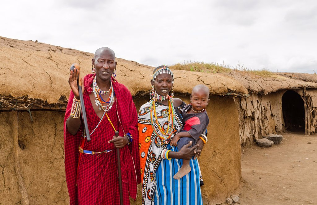 Stock Photo: 1566-1200106 Amboseli National Park Kenya Africa safari Masai couple with child welcome to village Amboseli Maasai, hut, mud, home, beads, red, color, 1