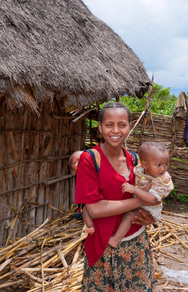 Stock Photo: 1566-1200163 Shashemene Ethiopia Africa Alaba tribe home with animals and yard for locals with woman with her babies in poor farm 10