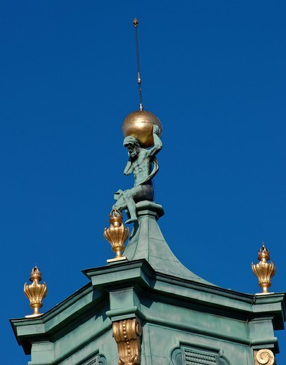 Figure of Atlas holding the celestial sphere at baroque spire on tower at Wilanów Palace in Warsaw, Poland : Stock Photo