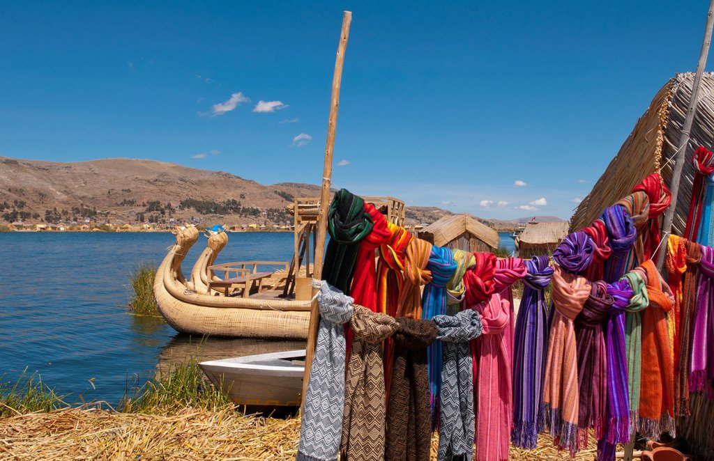 Lake Titicaca Peru with traditional scarfs for sale in floating islands near Puno : Stock Photo
