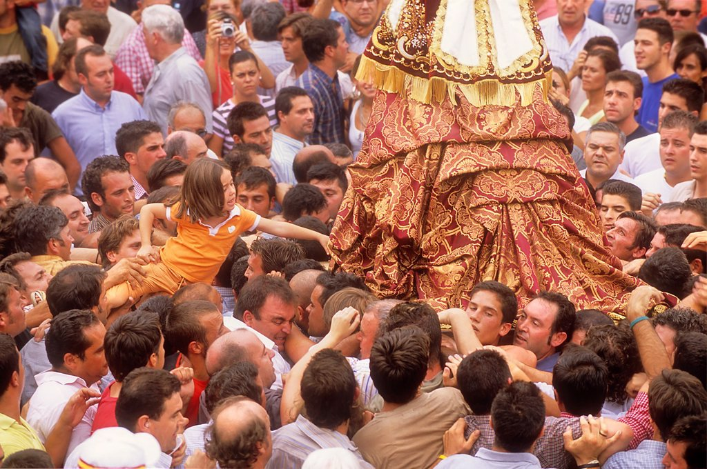 Stock Photo: 1566-1202196 El Rocío Romería pilgrimage,Special procession,once every seven years the virgin of el Rocío travels from El Rocío to Almonte where he spends a few months, to finally go back to El Rocío,procession trip from el Rocío to Almonte,girl is carried over the cr. El Rocío Romería pilgrimage,Special procession,once every seven years the virgin of el Rocío travels from El Rocío to Almonte where he spends a few months, to finally go back to El Rocío,procession trip from el Rocío to Almonte,girl is carried