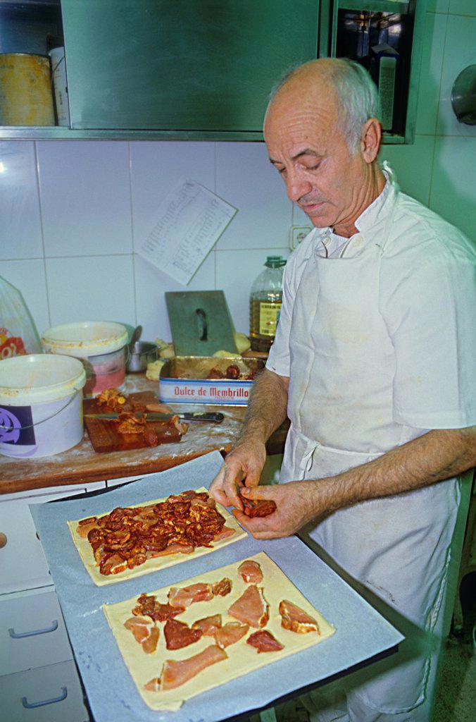 Man cooking the `hornazo´, typical food of Salamanca, La Industrial bakery, Rúa Mayor 8,Salamanca,Spain : Stock Photo