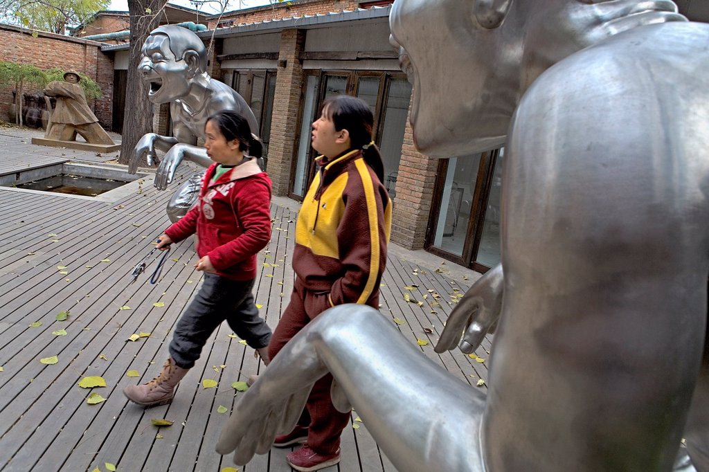 Stock Photo: 1566-1202674 Xin Dong Cheng Space for Contemporary Art  Nº4 Jiuxianqiiao Lu, in Dashanzi 798 Art District  Silver sculptures by Yue Min Jun and the sculture of color brown by Wang Gugangyi,Beijing, China