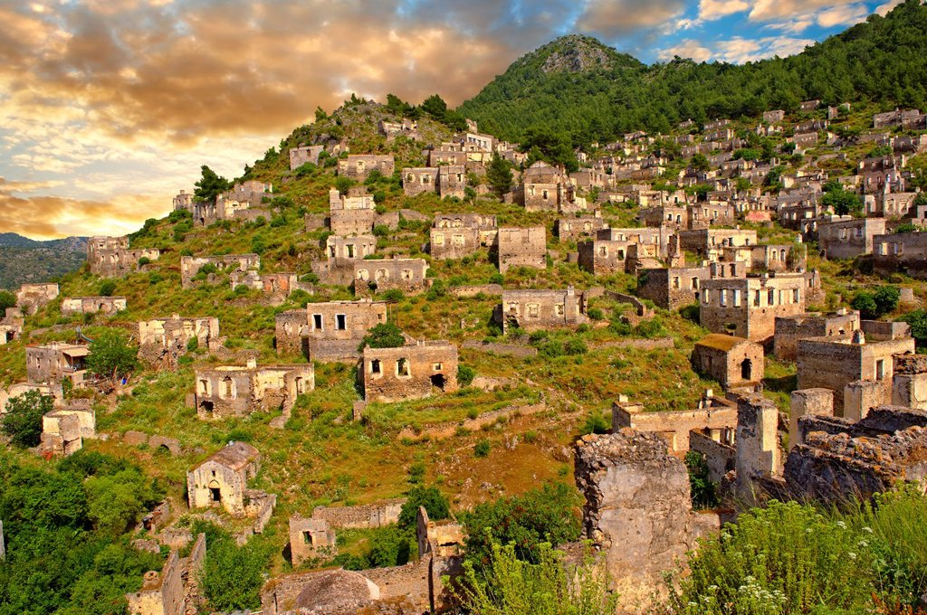 Stock Photo: 1566-1202763 Kayaköy Kayakoy or Karmylassos, an abandoned Greek Village 8km from Fethiye in Turkey whose inhabitants left as part of a population exchange agreement between the Turkish and Greek governments in 1923 after the Greco Turkish War
