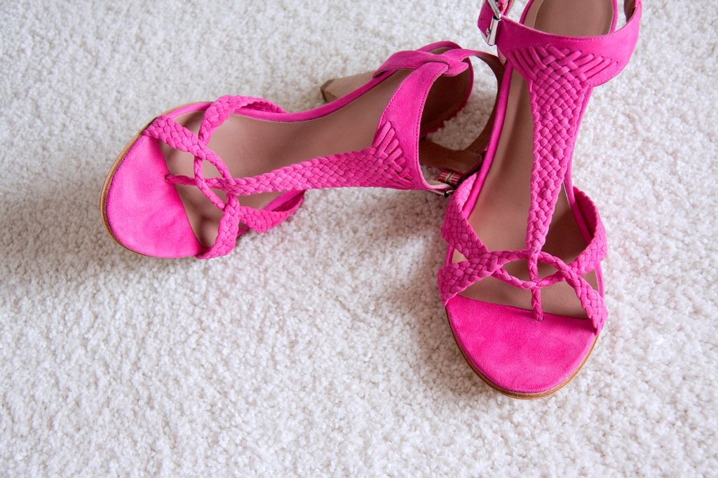 Woman´s pink sandals : Stock Photo