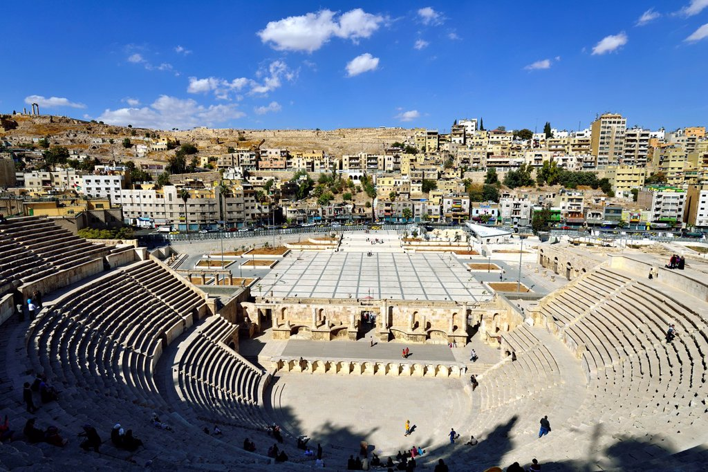 Stock Photo: 1566-1205086 Amman, Jordan  The Roman Theatre was built during the reign of Antonius Pius 138-161 CE  The large and steeply raked structure could seat about 6,000 people: built into the hillside, it was oriented north to keep the sun off the spectators  It was divided. Amman, Jordan  The Roman Theatre was built during the reign of Antonius Pius 138-161 CE  The large and steeply raked structure could seat about 6,000 people: built into the hillside, it was oriented north to keep the sun off the spectators  It