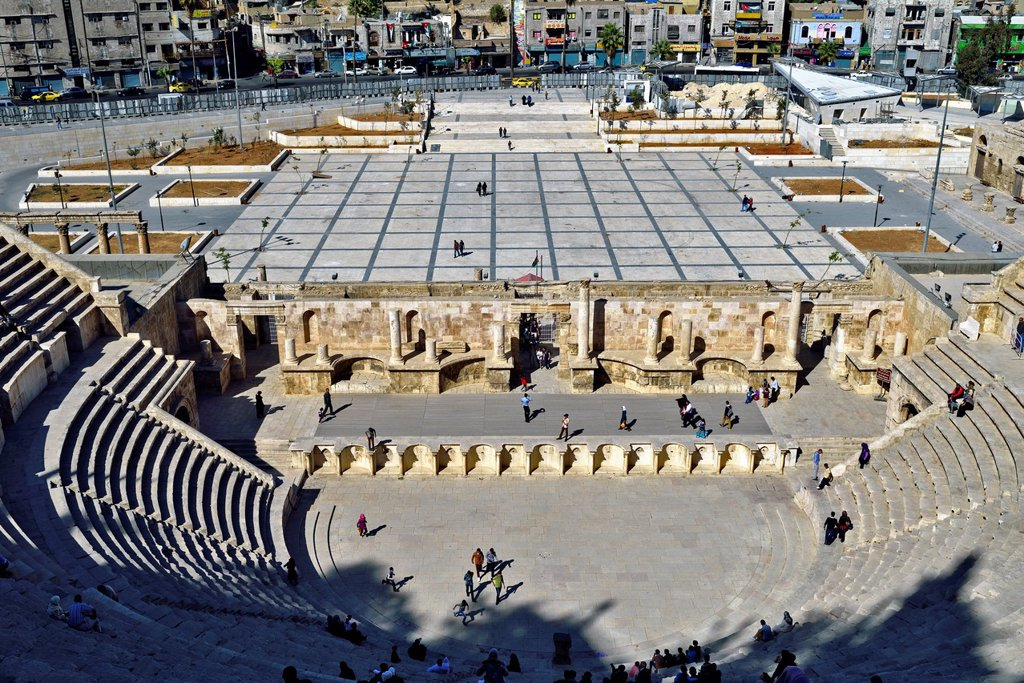 Stock Photo: 1566-1205089 Amman, Jordan  The Roman Theatre was built during the reign of Antonius Pius 138-161 CE  The large and steeply raked structure could seat about 6,000 people: built into the hillside, it was oriented north to keep the sun off the spectators  It was divided. Amman, Jordan  The Roman Theatre was built during the reign of Antonius Pius 138-161 CE  The large and steeply raked structure could seat about 6,000 people: built into the hillside, it was oriented north to keep the sun off the spectators  It