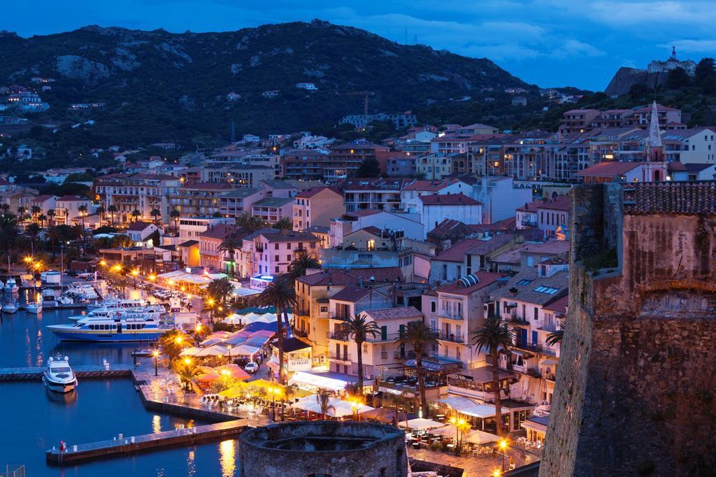Stock Photo: 1566-1209838 France, Corsica, Haute-Corse Department, La Balagne Region, Calvi, elevated view of the Port de Plaisance port, dusk