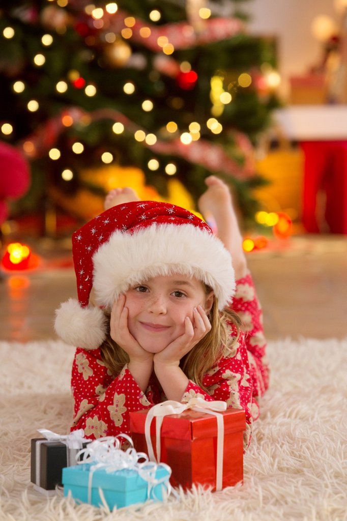 Young girl with gifts at Christmas time : Stock Photo