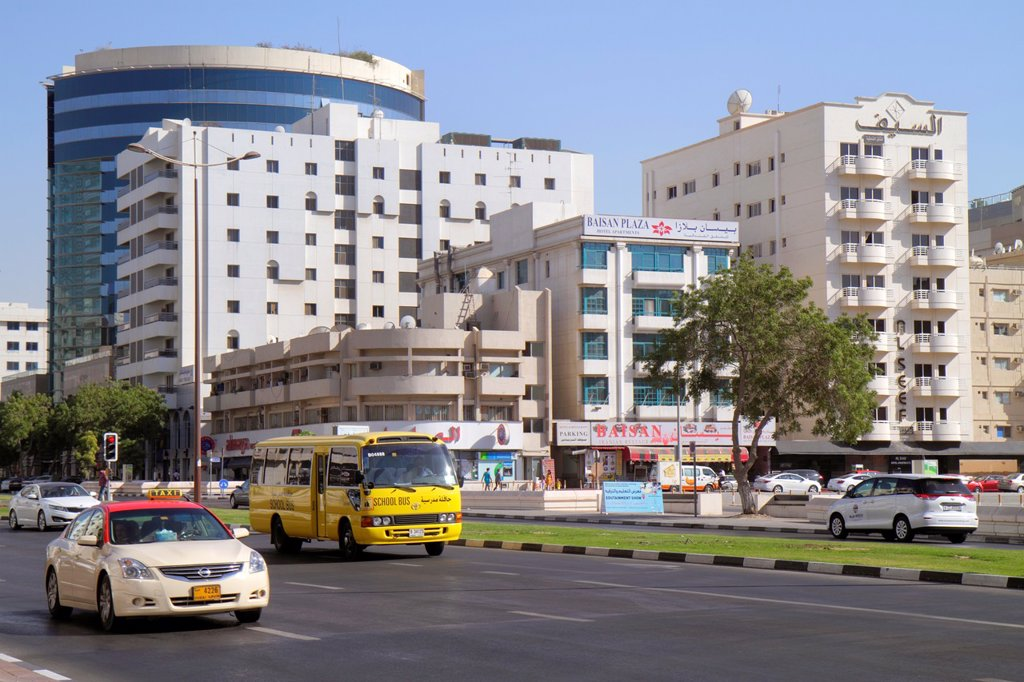 United Arab Emirates, U A E , UAE, Middle East, Dubai, Deira, Al Rigga, Al Rigga Road, English, Arabic, language, street scene, taxi cab, school bus, buildings, : Stock Photo