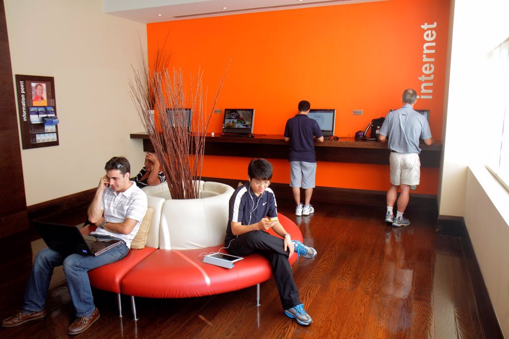 Stock Photo: 1566-1210664 United Arab Emirates, U A E , UAE, Middle East, Dubai, Deira, Al Rigga Road, Hotel ibis Al Rigga, hotel, lobby, Internet, access, computer, monitors, Asian, man, guests,