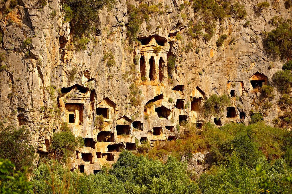 Stock Photo: 1566-1213438 The Hellenistic temple fronted Tombs of Kaunos, 4th - 2nd cent  B C , just outside the archaeological site of Kounos on the oposite side of the Calbys river from Dalyan, Turkey  Kaunos is on the border of Lycia & Caria and the Kaunos rock tombs differ sli
