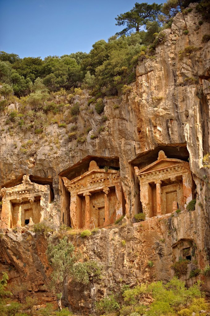 Stock Photo: 1566-1213441 The Hellenistic temple fronted Tombs of Kaunos, 4th - 2nd cent  B C , just outside the archaeological site of Kounos on the oposite side of the Calbys river from Dalyan, Turkey  Kaunos is on the border of Lycia & Caria and the Kaunos rock tombs differ sli