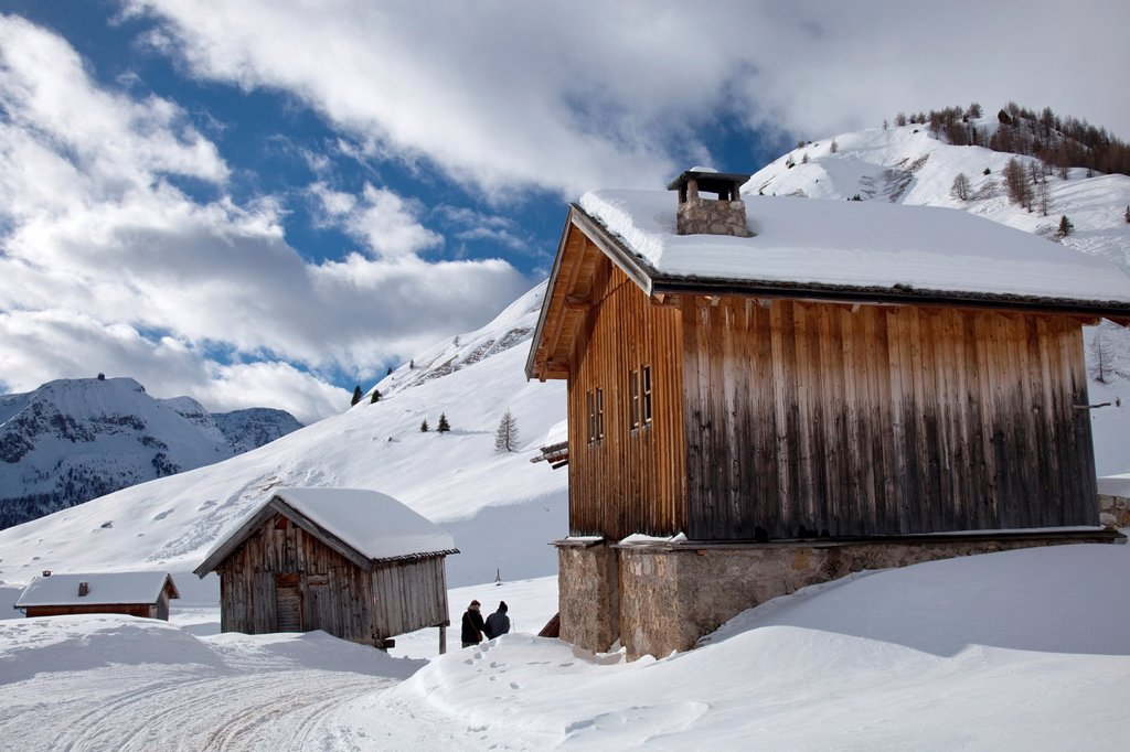 Stock Photo: 1566-1214275 Snow trail alongside wooden barns, near Fuciade hut, San Pellegrino pass, Trentino Alto Adige, Italy, Europe