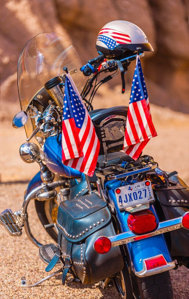 Stock Photo: 1566-1217643 A Harley-Davidson motorcycle parked along the Camino del Rio along the Rio Grande River, which is the border of the USA and Mexico, Big Bend Ranch State Park, Texas USA