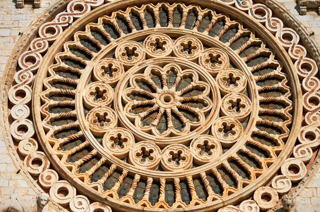 Romanesque Rose window of the Papal Basilica of St Francis of Assisi,  Basilica Papale di San Francesco  Assisi, Italy : Stock Photo
