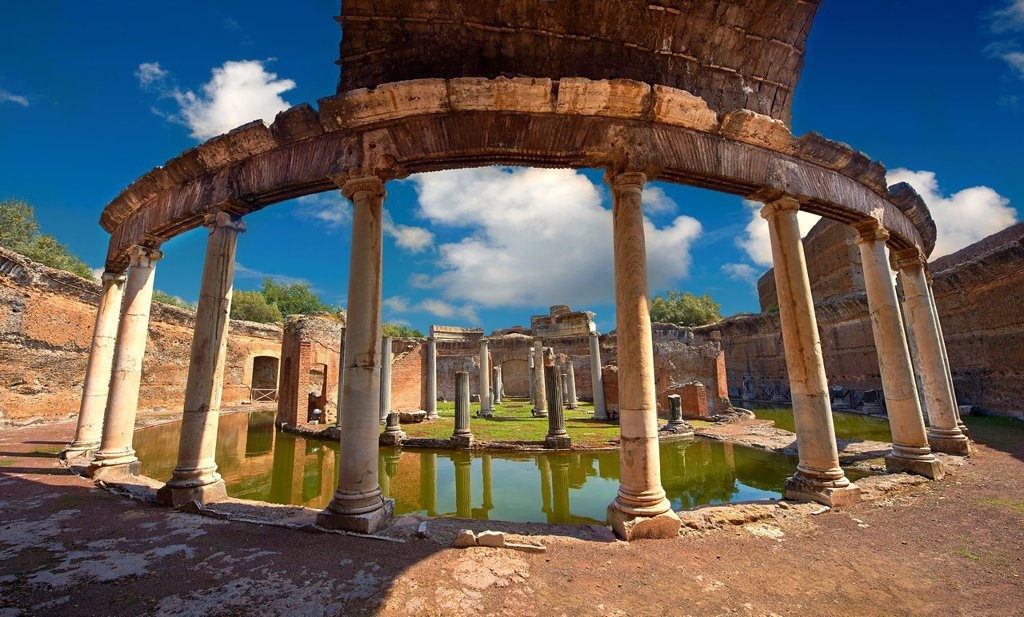 Stock Photo: 1566-1219565 Hadrian´s Villa  Villa Adriana  2nd century AD - The Maritime Theatre  Teatro Marittimo , so called because of its shape and marine architectural decorations such as Tritons, is at the centre of Hadrian´s Villa complex  At its centre of the Teatro Marittimo is a circular islet surrounded by a water filled moat which in turn is surrounded by a circular barrel vaulted portico with 40 Ionic columns  The circular building on the islet consisted of rooms that surrounded a central peristyle which was