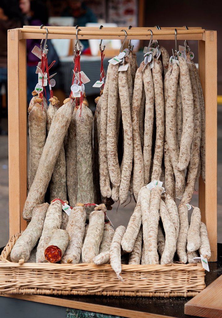 Stock Photo: 1566-1219886 Selection of salami sausage hanging up in a market stall