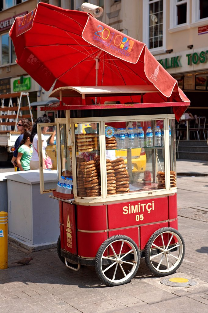 Traditional bread ring seller stiklal Avenue or Istiklal Street  stiklâl Caddesi, French: Grande Rue de Péra, or Independence Avenue one of the most famous avenues in Istanbul, Turkey : Stock Photo