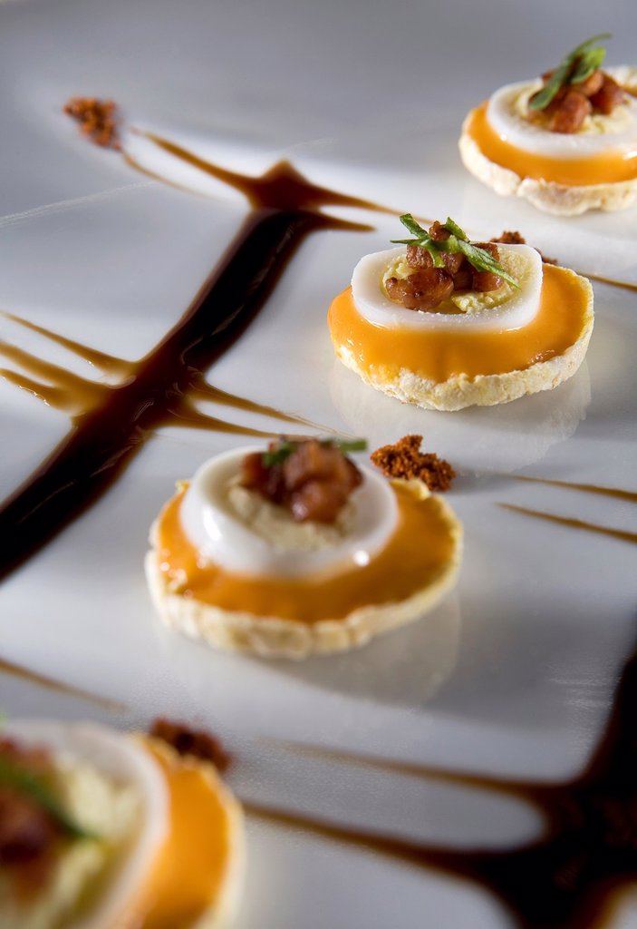 Catering recipe: Quail Eggs, bacon and ´salmorejo´ on corn chips : Stock Photo