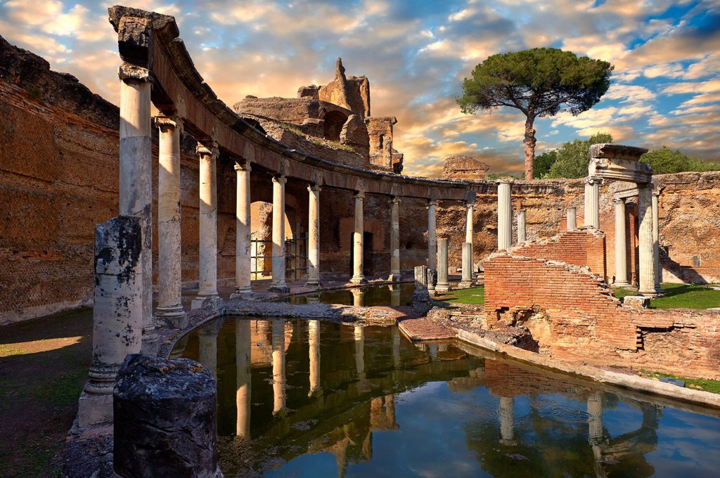 Stock Photo: 1566-1221778 Hadrian´s Villa  Villa Adriana  2nd century AD - The Maritime Theatre  Teatro Marittimo , so called because of its shape and marine architectural decorations such as Tritons, is at the centre of Hadrian´s Villa complex  At its centre of the Teatro Marittimo is a circular islet surrounded by a water filled moat which in turn is surrounded by a circular barrel vaulted portico with 40 Ionic columns  The circular building on the islet consisted of rooms that surrounded a central peristyle which was