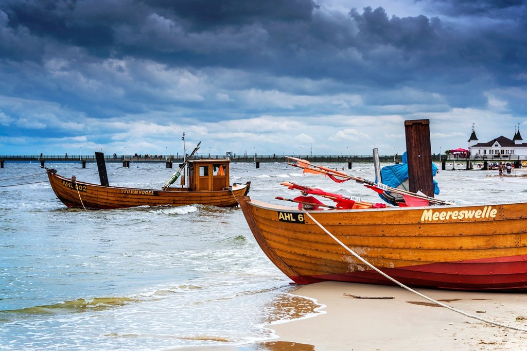 Two Fishing boats at the beach of the Baltic Sea, near the pier of the Baltic Sea resort of Ahlbeck, Municipality of Heringsdorf, Usedom Island, County Vorpommern-Greifswald, Mecklenburg-Western Pomerania, Germany, Europe, No Property Release available! : Stock Photo